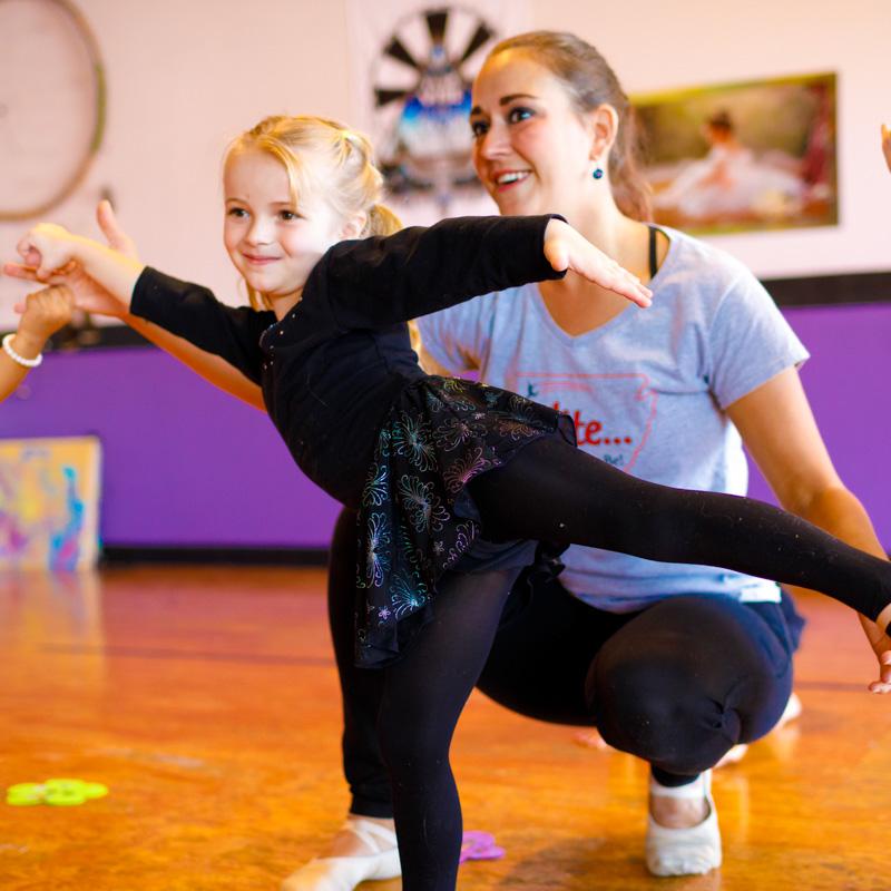 Miss. Virginia Mock assisting beginning dancer.
